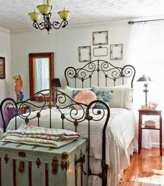 Vintage Bedroom: What a charming room, with an ornate iron bed frame, chenille bedspread and a lovely vintage trunk. Photo Credit: digsdigs