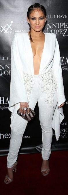 Who made Jennifer Lopez's white jumpsuit and clutch handbag?