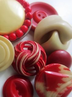 Creamy vintage red and white celluloid buttons.  Love buttoms and love red.  What's not to like?