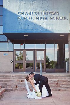 high school sweethearts... in front of their high school. i like this idea