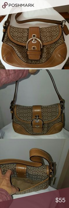 """Coach Signature Classic C small bag Coach Signature Classic C small tan handbag with leather trim. Authentic Coach handbag like new condition used a handful of times. Very spacious even though its a smaller handbag. 7"""" high and 9"""" long.  Open to reasonable offers. Coach Bags Hobos"""