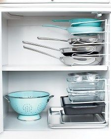 You can remove one pan without having to remove them all. Turn a vertical bakeware organizer on its end and secure it to the cabinet wall with cable clips. via Martha Stewart clean-and-neat ~ I so need this!!