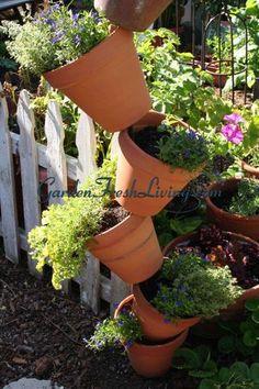 http://www.gardenfreshliving.com/2009/07/defy-gravity-with-a-flower-tower.html