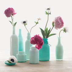 Floral design inspiration: Single buds in glass milk jugs you can find at thrift stores or flea markets.