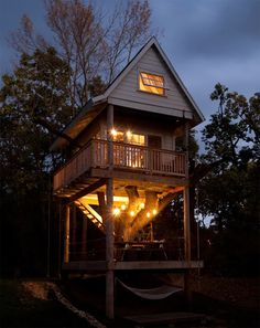 super-deluxe tree house that you can rent in Wandawega Lake Resort in Wisconsin U.S.. Built entirely from recycled materials, there is a dining terrace house on the ground floor including a cozy hammock dangling. Note the atmospheric lighting made from old glass jars.