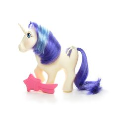 This vintage G1 My Little Pony is Glory, she's a unicorn pony from Year 2. She's white with blue a purple and teal mane and purple tail, and a glittery shooting star for her symbol, and blue eyes. The