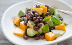 Mango, Avocado and Black Bean Salad with Lime Dressing // Tropical flavors of mango and citrus complement black beans in this colorful salad! #recipe #summer #salad