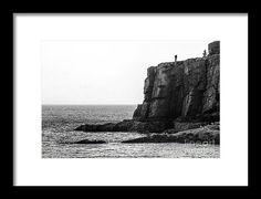 Rock climbing on Otter Cliffs. Acadia National Park, Maine.