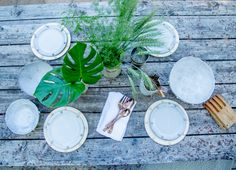 Summer entertaining at LUX / LODGE hollywood hills Aframe. Table filled with handmade LUX / EROS Ceramics in Snow white and gold with green leafy florals.