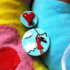 Cute polymer clay pins, girl holding on to heart shaped balloon, floating away