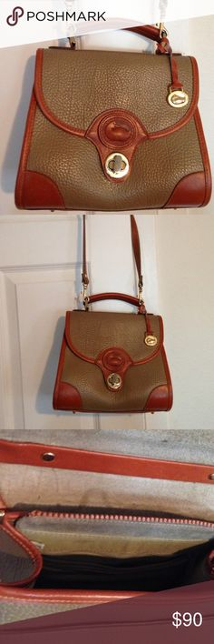 Vintage Dooney and Bourke Shoulder Bag Gorgeous vintage Dooney and Bourke shoulder bag. Top handles and removable shoulder strap. Medium size. Color is dark taupe and brown all weather leather. Made in China tag on the inside, as some of the earlier models were made in China. Gorgeous bag. Dooney & Bourke Bags Shoulder Bags