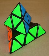 The Pyraminx - like the Rubiks cube, but this one I actually could solve... Still have it too!