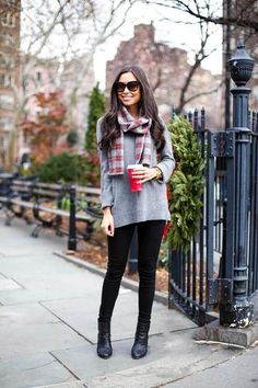casual winter outfit idea - gray oversized sweater, black skinny jeans + boots and a plaid scarf