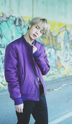 Jin from BTS (oh no, watch out - kpop bands wear LOTS of colorful shirts, including purple!