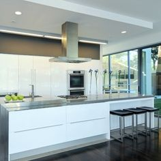 A soffit box can mirror the dimensions of the island, as well as provide additional lighting. Click the image to visit our website for more information on kitchen soffit designs.
