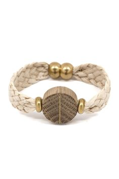 This bracelet is made with handwoven silk and accentuated with a wooden chevron bead. The bead features a graphic use of wood grain and is highlighted by two vintage brass beads. Dimensions: Measures