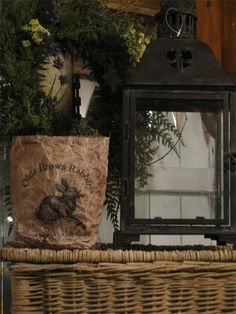 Rustic Easter display without being in your face about it.  Would look even prettier with a few off white and cream eggs in the lantern.