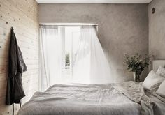 Gravity Home: Serene grey and wood bedroom