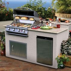 """Give """"let's eat out"""" a new meaning when you build an outdoor kitchen. This island comes with a stainless steel propane gas grill, granite top, and 6 cu. ft. fridge. Just add guests and it's a party! Click through for DIY details."""