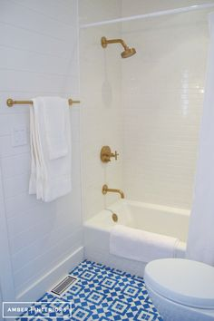 tongue and groove wall panelling, white subway tile in shower, Granada Fez cement floor tile, basic shower curtain rod