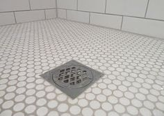 Penny Tiles for Shower Floor  White penny mosiac and subway tiles, grout in Dunlop Misty Grey