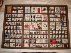 great idea for small cross stitch motifs.  this looks like the xstitches are framed in a shadow box