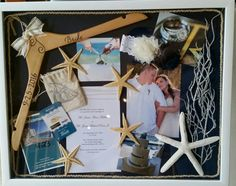 Beach wedding shadow box, included in my box, my garter,my hanger, hotel room key, favor bags, invitation,coral from our center pieces, star fish from the ceremony table, gold rope from the ceremony table and pictures.