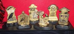 I just finished making my trophies for this year's costume contest.They are made out of the cement decorations from the Dollar Tree and wooden plaques from Hobby Lobby. I didn't like the cement look they had, so I painted them gold to make them look kind of fancy. I tried to bring out the details by using black and sometimes black mixed with gold. Each one cost about $1.50 is all, but they look more expensive. For the labels, I dug out my old electronic typewriter (it still works