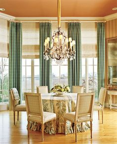 Love the pop of color, and painted ceiling in this neutral dining room.