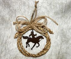 Western Cowboy in Rope Circle Christmas Ornament via Etsy. would be cute in center of wreath. Western Christmas Tree, Cowboy Christmas, Primitive Christmas, Country Christmas, Winter Christmas, Primitive Fall, Primitive Crafts, Cowboy Crafts, Western Crafts