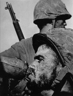 608. W. EUGENE SMITH. Marines under Fire, Saipan, 1943.  Gelatin silver print.