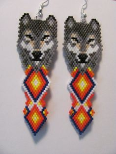 Here is a lovely pair of hand beaded grey wolf with double diamond earrings. They measure 1 X They were designed by Mary Hipple and beaded by me one bead at a time in a smoke free home I do combine shipping Thank You for looking Beaded Earrings Patterns, Seed Bead Patterns, Bead Earrings, Etsy Earrings, Beading Patterns, Diamond Earrings, Hama Beads Design, Diy Perler Beads, Native American Crafts