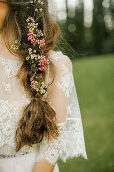 Not feeling the flower crown for a boho wedding? Try a floral braided bridal hairstyle instead - you get the undone whimsy that's so boho but it feels fresh and new all over again.