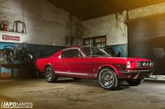 This 1966 Ford Mustang is absolutely stunning in bright red.