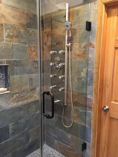 A range of colors from dark blue to burnt red to purplish brown gives this natural slate a dramatic feel for your bathroom shower tile design - Copper Rust 8 x 24 in