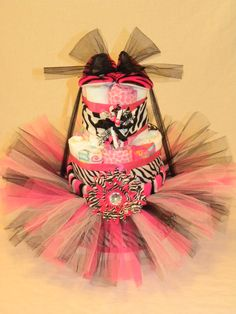 Pink and Zebra Diaper Cake, no zebra print or any other print for this baby!! I think its super cute though