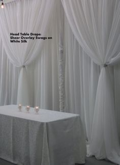 Here is the white two layered backdrop..and don't worry the pole in the center, wont be visible..