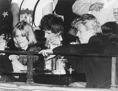 Patti Hansen with husband Keith Richards having a drink with David Bowie, late 1983 - early 1984.