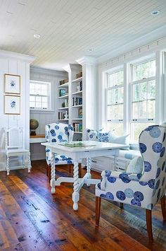 Beach House, Designed by Sarah Richardson Design: Natalie Hodgins & Kate Stuart - Fresh blue and white dining area with wing chairs. Love the antique hardwood floor and crisp white walls Blue And White Fabric, White Fabrics, Corner Desk, Nautical Nursery, Nautical Home, Beach Cottage Style, Beach House, Chair Fabric, Furniture