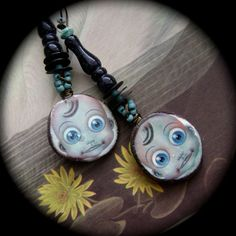 Surprise earrings by Anvilartifacts