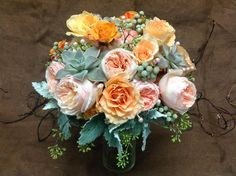 Roses, Silver Brunia, Succulents and Seeded Eucalipto.