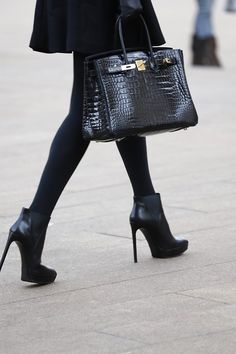 Love black leather heels, tights with the bag