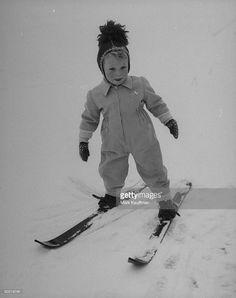 Prince Carl Gustaf XVI wearing snowsuit & skies, playing at Haga Castle Park.