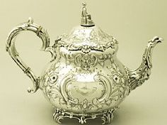 A fine and impressive antique Victorian English sterling silver Louis teapot; an addition to the silver teaware collection. SKU: W8946 Price: GBP £1,595.00 http://www.acsilver.co.uk/shop/pc/Sterling-Silver-Louis-Teapot-Antique-Victorian-49p6286.htm#.U8o0f0BXoUM