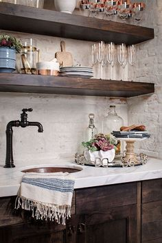 Farmhouse butler's pantry with dark cabinets, white marble countertop and painted brick backsplash. Accessories – Anthro​po​logie​, ​ Pottery Barn​, ​ Face to Face​, Creative Coop​, ​ Global Views Copper Sink – Premier Copper Products Faucet – Kohler (Artifacts Gentleman's Bar Sink Faucet)