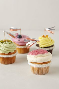 """Cake Tassel:Cotton, wood10""""H Cupcake Flags:Set of 12Felted wool, cotton, wood3""""HHandmade in USA"""