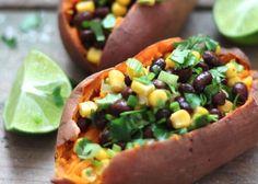 sweet potato stuffed with black beans, corn, green onions