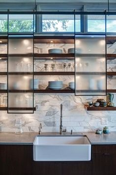 What a great concept for kitchen upper cabinets! The sliding glass doors mounted on rails above the open shelving are sleek. Great modern alternative to traditional cabinetry or completely open shelves. Classic Kitchen, New Kitchen, Kitchen Decor, Kitchen Ideas, Semi Open Kitchen, Decorating Kitchen, Country Kitchen, Contemporary Kitchen Cabinets, Contemporary Kitchens