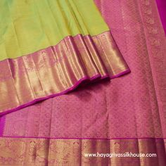 Green or Pink? Why not both? Drape yourself in this gorgeous six yard wonder in a colour combination of light green and red. The designs on the Saree are embellished with gold zari work.  #WeddingSilkSarees #BuySareesOnline #KanjivaramSilkSaree #Hayagrivas #WeddingKorvaiSilkSari