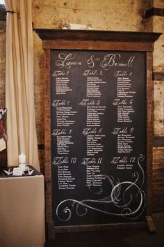chalkboard seating assignment - find piece at salvage yard and spray paint w/chalkboard paint.